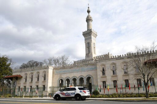 (AP Photo/Susan Walsh). A police vehicle is parked outside the Islamic Center of Washington, Friday, March 15, 2019 in Washington.